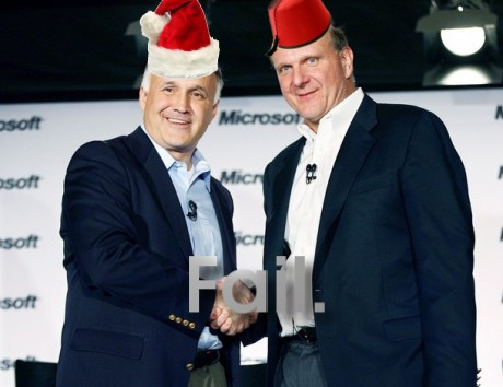 Ron Hovsepian and Steve Ballmer with red hats