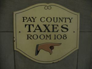 Pay taxes (sign)