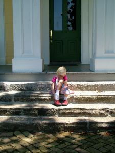 Sad girl on steps