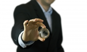 Businessman holding a crystal globe