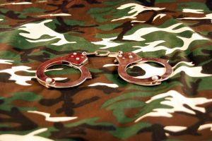 Handcuffs on camouflage