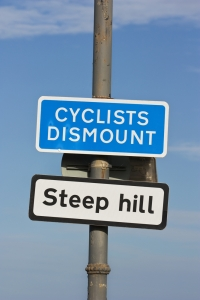 """Cyclists dismount"" sign"