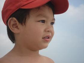 Boy with Red Hat