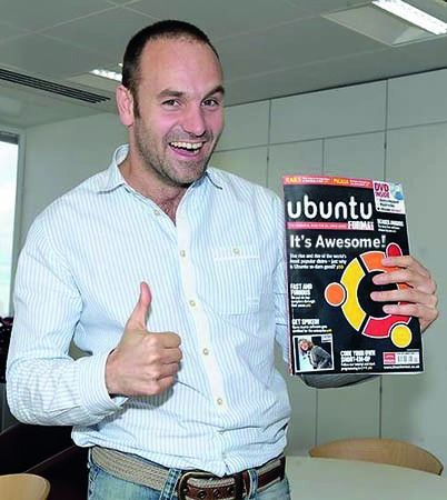 Mark Shuttleworth with magazine