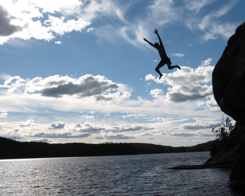 Man jumping in lake