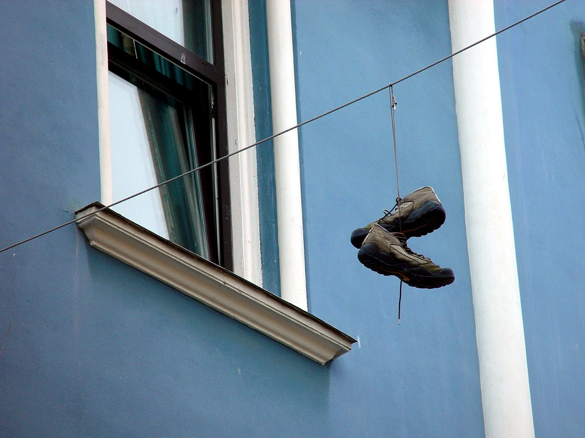 Shoes on string outside a window
