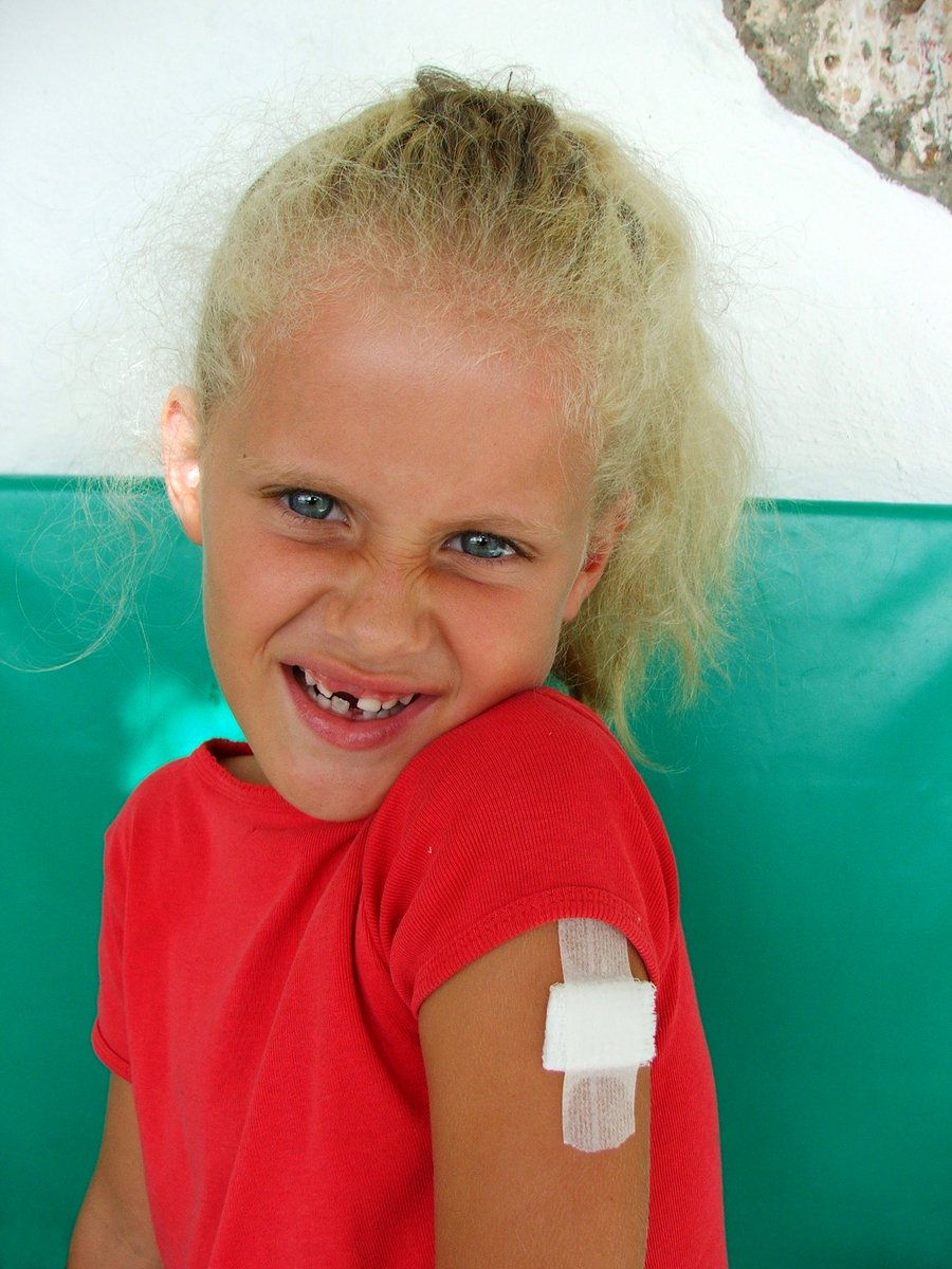 Girl with plaster & missing tooth