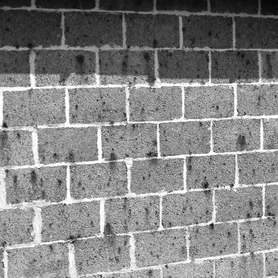 A stained brick wall